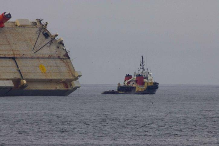 small ship with big cargo ship aground 725x483 1